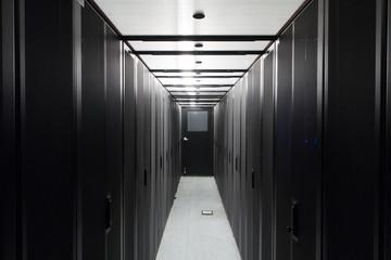 Symmetrically telecommunication racks in sealed corridor.