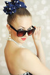 Photo of beautiful young woman with sunglasses. Vintage style