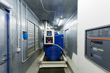 Diesel generator for backup power in room with control panel