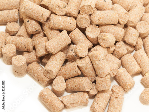 granules of Wheat Bran background. Food for horses and farm anim