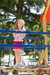 Cute little girl is climbing up on ladder in playground