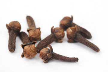 Cloves Scattered on White Background