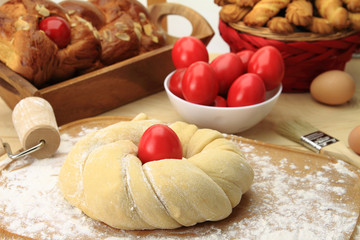 Easter sweet bread dough with red eggs