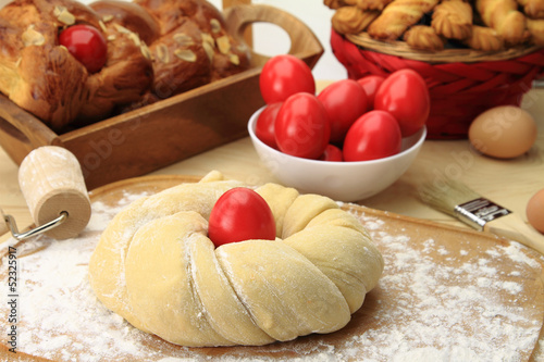 Fotobehang Brood Easter sweet bread dough with red eggs