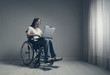 Disabled young woman using laptop