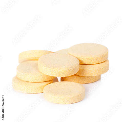 yellow vitamin pills isolated on white