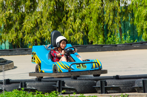 Cute Thai girl is driving Go-kart in race course