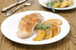 Baked chicken and saute quince with rosemary closeup
