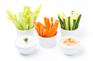 assorted fresh vegetables and two yogurt sauce isolated