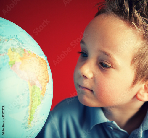 boy looking at south america