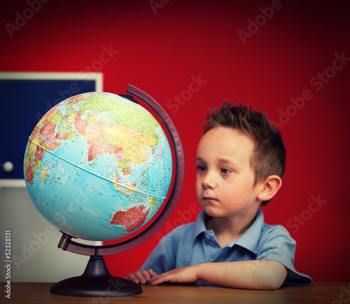 school boy with globe