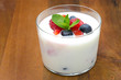 yogurt with different berries and mint in a glass beaker