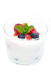 yogurt with different fresh berries in a glass beaker isolated