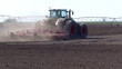 Big tractor preparing land for sowing