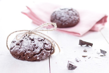 Fresh chocolate cookies on white wooden background