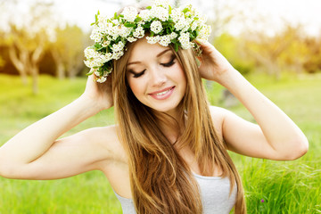 beautiful girl in wreath of flowers