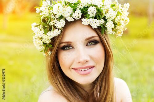 beautiful girl in wreath of flowers