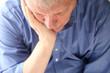 older man slumped in depression