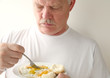 man having fried eggs and biscuits