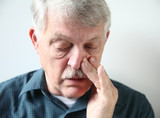 man with stuffy nose from allergies or cold