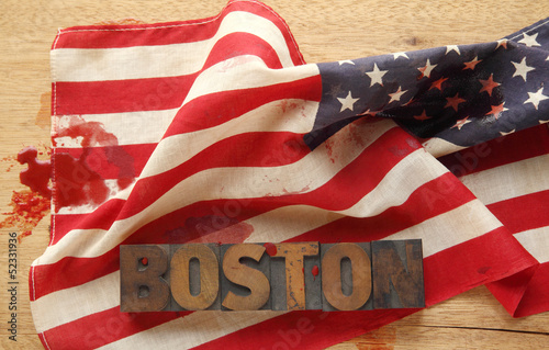 Boston word on a bloodied American flag