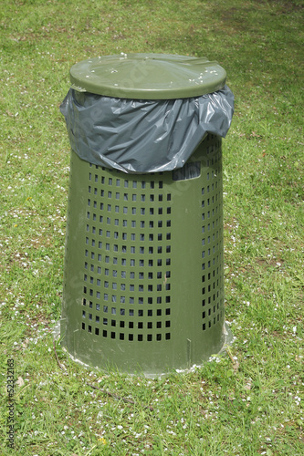 Green garbage can