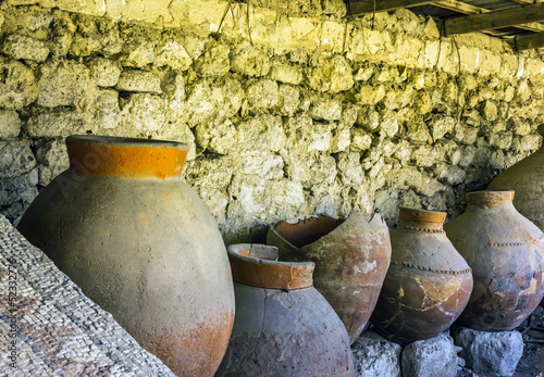 old clay pot excavations into ancient city ruins close up