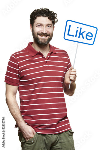 Young man holding a social media sign smiling
