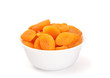 dried apricots in a bowl on white