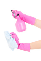 female hands in rubber gloves with spray and rag