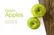 Green apples and white paper