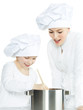 Mother and child have fun in the kitchen, cooking together