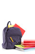 Studio shot of a school backpack with books and notebooks