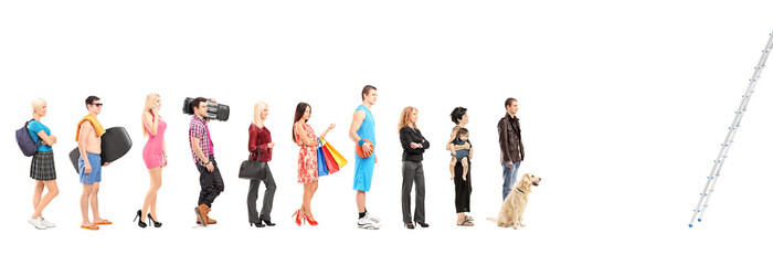 Full length portraits of people in a queue waiting to climb a la