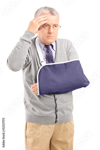 Middle aged man with a broken arm