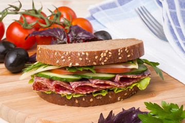 Sandwich with sausage and vegetables
