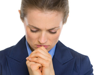 Portrait of praying business woman