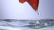 Fresh strawberry under water with a splash.
