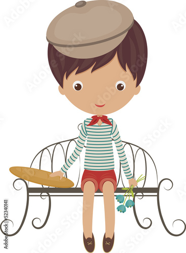 Little french boy sitting on a bench with baguette and flowers