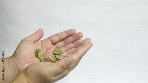 Gold coin on hand