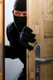 Burglary crime - burglar opening a door