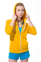 Portrait of modern teenager girl adjusting draped hood