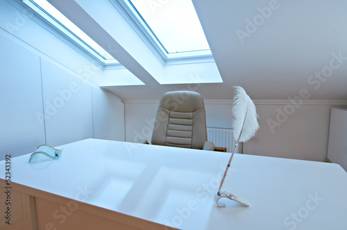 Desk and chair in a room corner