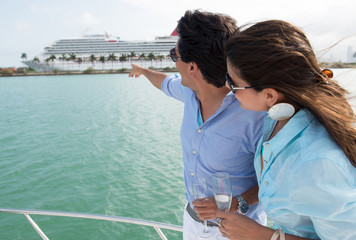 Couple pointing at a cruise