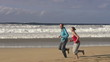 Couple jogging on the beach, super slow motion, shot at 240fps