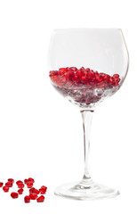 fresh grains of pomegranate in wine glass