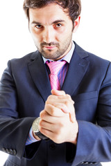 Portrait of succesful businessman rubbing hands
