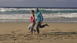 Couple jogging, race on the beach