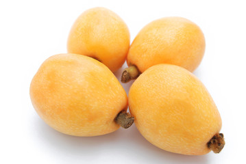 fresh loquat medlar fruit on white background