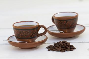Set de cafe, granos de cafe, azucarera y tasas.